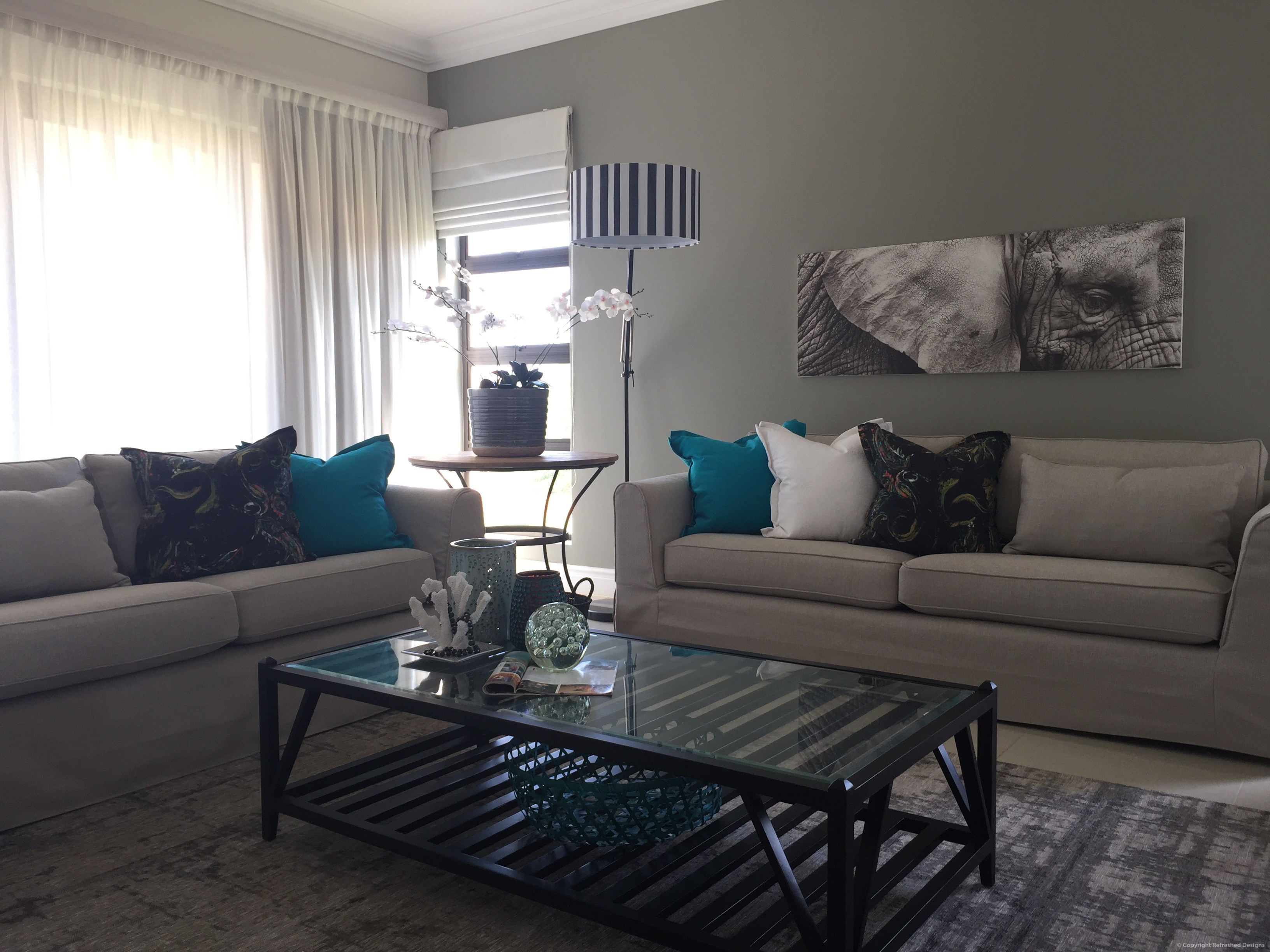 Refreshed Designs, Interior decor, lounge, coffee table, furniture, couch, scatters, floor lamp, orchid